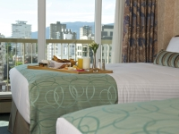 2011-pics-comfort-room-beds-with-breakfast-tray-low-res
